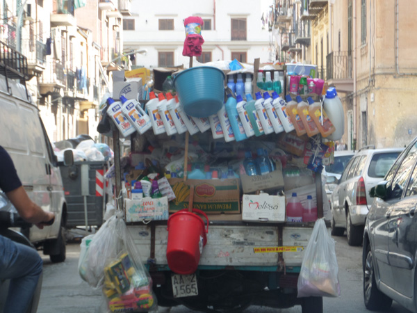 Soap Vendor in Palermo Selling Goods on a 3-Wheeler